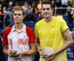 Sam Querrey of the U.S. and compatriot John Isher hold their trophies after the Memphis Open tennis tournament